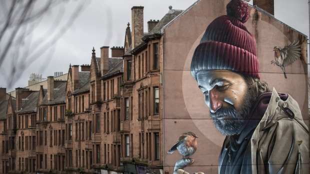 One of Glasgow's best-known murals, by street artist Smug, depicts a modern-day St Mungo which references the story of ...