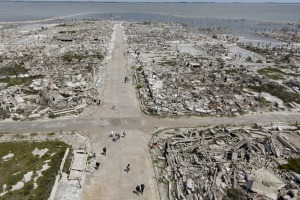 Tourists walk along the main street of the abandoned Villa Epecuen, Argentina.