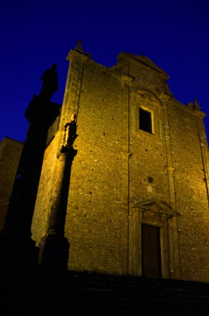 The 14th century abandoned monastery in Volterra lit up at night.