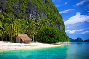 True colours ... (from left) the turquoise waters of Bacuit Bay; a lone outpost on the sands of a Palawan beach; the ...