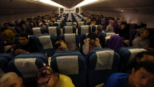 Passengers remain in their seats on-board Malaysia Airlines flight MH318 as it cruises towards Beijing over the South ...