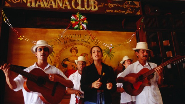 Cuban collective ... musicians perform in the Bar Havana Club.