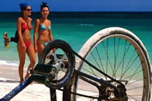 Upturned bike on beach, Cuba