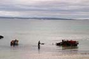 Fishing boats are launched from tractors which drive down the beach at Tomahawk