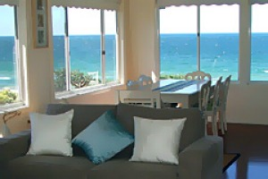 Beachfront bliss ... the Beach House's open-plan living areas with ocean views.