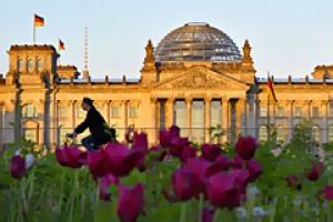 Bloc party ... a rider passes the Reichstag building, Germany's lower house of parliament.