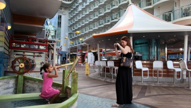 Sarah Behle takes a photograph of her daughter, Hayden Behle, 5, on board the cruise ship Oasis of the Seas.