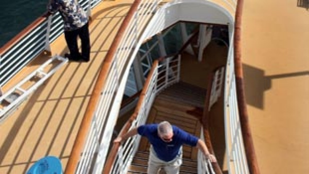 People take in the sights as they walk around on board the cruise ship Oasis of the Seas.