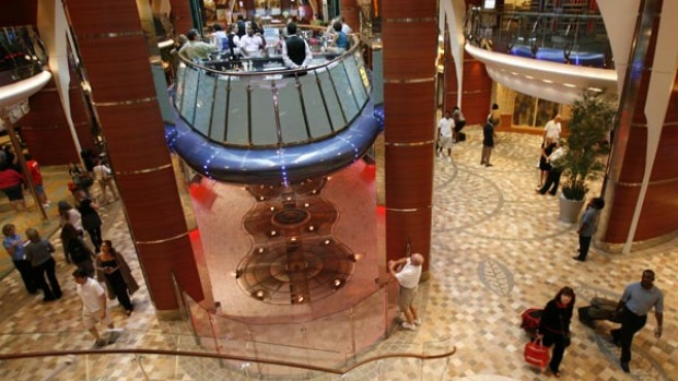 An elevator bar floats up and down between three levels on the world's largest cruise ship, the Oasis of the Seas.