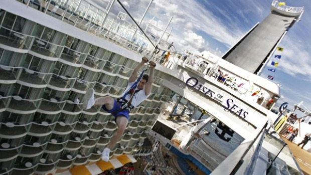 A zip-line is one of the sports activities on the world's largest cruise ship, the Oasis of the Seas. It also has four main swimming pools, a park promenade, surf simulators, rock climbing and a miniature golf course.