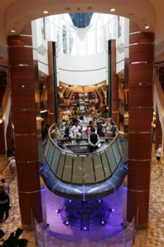 An elevator bar floats up and down between three levels on the world's largest cruise ship Oasis of the Seas docked at ...