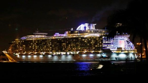 The Oasis of the Seas, the world's biggest cruise ship, is lit up at night in Port Everglades, Florida.