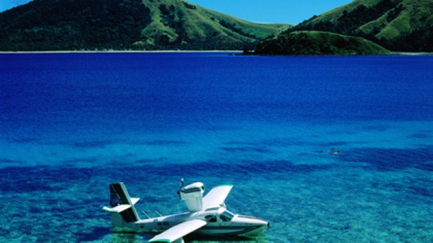A plane in the shallow waters near the island of Sawa-i-Lau.