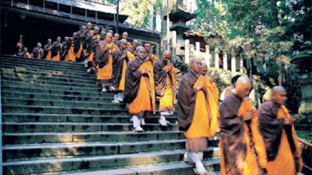 Wise steps ... a procession of Shingon Buddhist monks leaves Torodo temple in Koyasan.