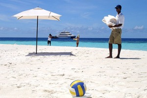 This is the life ... personal assistant Raj tends to everyone's needs on Tasty Sand Island.
