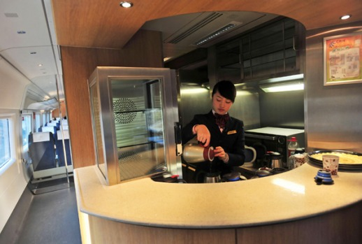 An attendant works at a cafe bar on a newly launched bullet train.