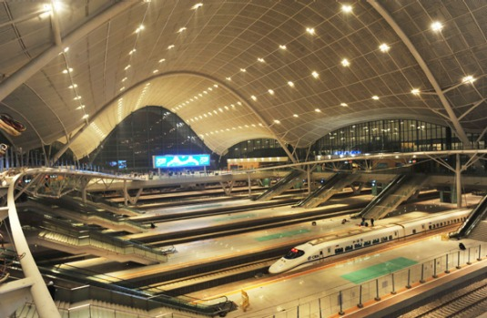 Chinese workers put the final touch on the interior of the new railway station in Wuhan.