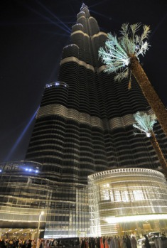 Burj Dubai tower, the world's tallest skyscraper, is lit by laser lights during its opening ceremony.