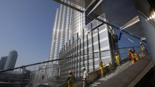 Workers complete the finishing touches before the official opening of the Burj Dubai.