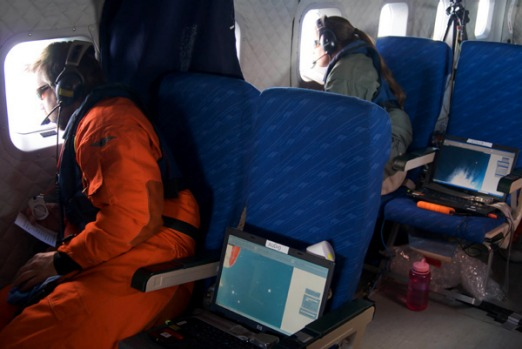 Not your average passengers. Whale researchers over Anntarctica.