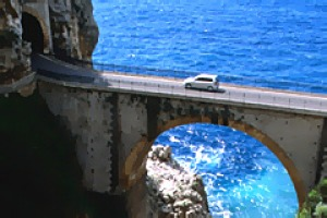 A car crossing the bridge (Vallone di Furore) on the Amalfi Coast.