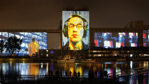 Off the wall ... Image Mill beamed on to grain silos in Quebec City.