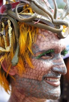 A man dressed up and calling himself The Viper dances along with the Ipanema band, the city's most famous carnival ...