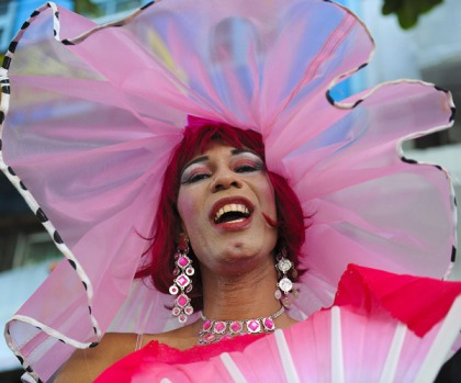 A drag queen calling himself Woman in Pink dances along with the Ipanema band.
