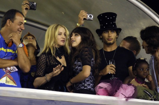 Madonna and her daughters Lourdes (C) and Mercy (2nd R) watch the Carnival parade of samba schools with Rio de Janeiro ...