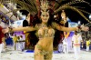 A member of the Viradouro samba school performs during the first night of Rio de Janeiro's famed carnival parades.
