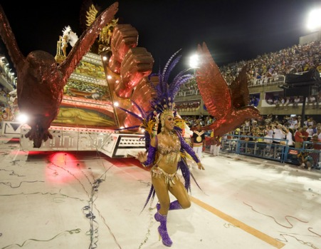 A member of the Viradouro samba school performs ahead of a float representing the Mexican pyramids.