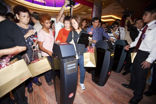 The first group of punters enters the Resorts World Sentosa in Singapore as it opens.