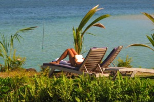 Business as usual on Savai'i as a tourist relaxes in the sun.