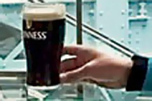 Knees up ... the Guinness Storehouse in Dublin is designed to resemble the inside of a pint glass.