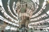 Reichstag, Berlin, Germany. A huge, shiny glass dome caps a building that was partially burnt down in 1933. The dome ...
