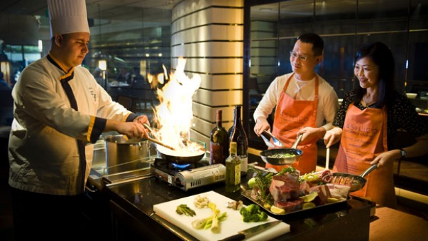 Social sizzle ... the Regent hotel in Singapore offers cooking classes for guests.