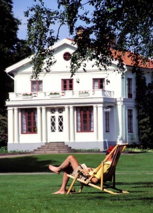 Salute to the sun ... relaxing in Tradgardsforeningen, the 19th-century park beside the canal.