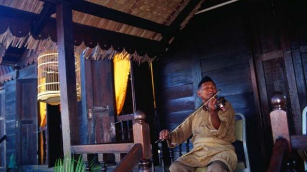 World heritage ... a fiddler fiddles within the walls of historic Fort Cornwallis.