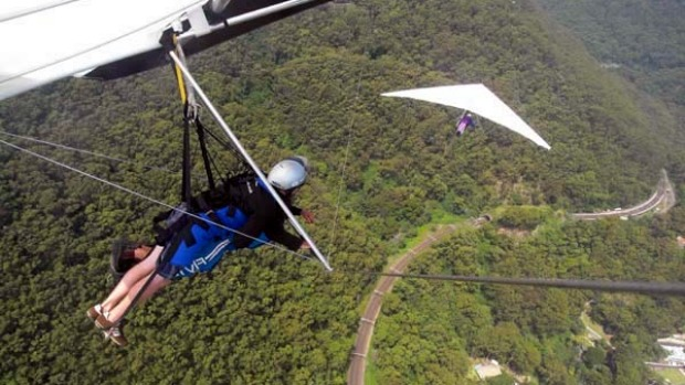 Fly by wire ... Curt Warren and Ben Stubbs glide over Stanwell Tops.