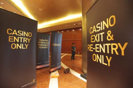 A security officer stands at the casino entrance of the Marina Bay Sands.