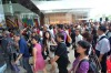 People queue up to enter the Marina Bay Sands as it opens.