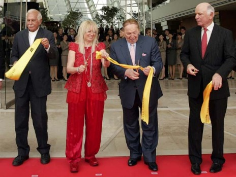 Las Vegas Sands CEO Sheldon Adelson (2nd R) cuts the ribbon next to his wife Miriam, architect Moshe Safdie (L) and Las ...