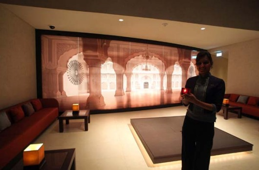An employee stands at the entrance of an Indian restaurant at the Armani hotell