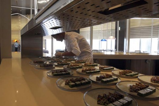 A restaurant staffer prepares meals at one of the restaurants at Armani Hotel.