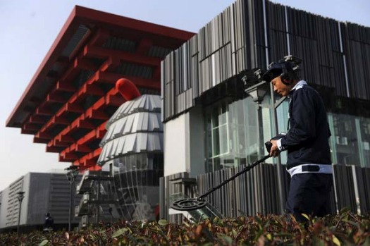 A policeman searches for possible bombs near the China Pavilion at the Shanghai World Expo site.