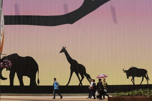 Visitors pass the African pavillion on the first day of the World Expo 2010 in Shanghai.