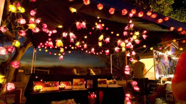 Light fantastic ... Mindil Beach Sunset Markets is a sprawling series of 300 stalls and a social hub.