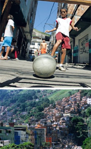 Slum city ...a boy plays football in the favela; (below) Rocinha is only a kilometre from Rio's famed beaches.