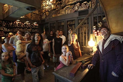 At Ollivander's Wand Shop helps visitors pick out a magic wand at The Wizarding World of Harry Potter at Universal ...