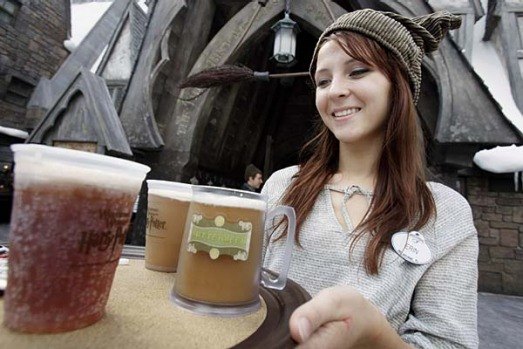 Erin Wuchte serves up Butterbeer to guests at The Wizarding World of Harry Potter at Universal Orlando theme park in ...